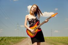 Free Girl With Guitar At Countryside. Royalty Free Stock Photos - 20064448