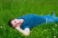 The Young Man Lies On Green Meadow Stock Image