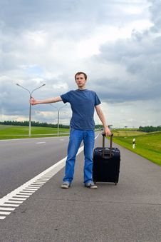 Free The Young Man Pending On Road With Suitcase Stock Photography - 20070462