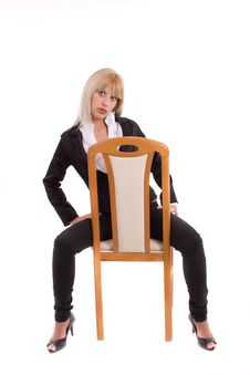 Free Girl Sitting On Wooden Chair Isolated Over White Stock Photos - 20070653