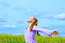 Free The Girl On A Green Meadow Royalty Free Stock Image - 20070696