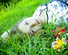 Free The Beautiful Girl With Green Eyes On A Grass Royalty Free Stock Image - 20075436