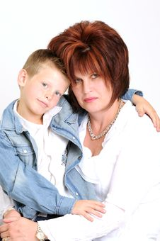Sexy Mother And Teen Son Hugging And Smiling Smart Stock Photography