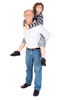 Free Grandfather Giving Grandson Piggy-back Royalty Free Stock Photos - 20079118