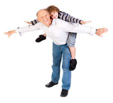Free Grandfather Giving Grandson Piggy-back Royalty Free Stock Photography - 20079157