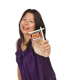 Multiethnic Woman Holding Sold Real Estate Sign