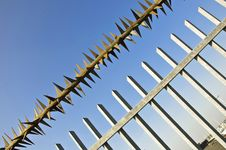 Free Barbed Wire Fence At The Blue Sky Royalty Free Stock Photo - 20085885