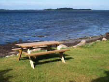 Free Outdoors Picnic Table By The Beach Royalty Free Stock Image - 20086386
