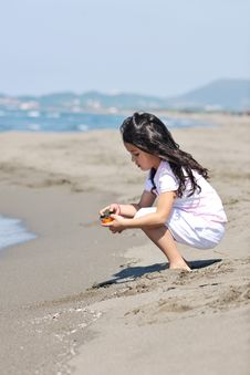 Free Little Female  Child Portrait On The Beach Stock Image - 20087421
