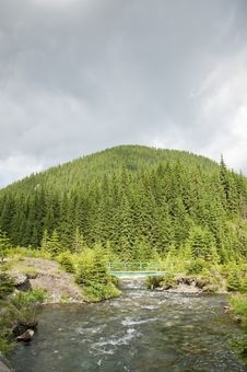 Free Clear Mountain Brook And Bridge Crossing Royalty Free Stock Image - 20087916