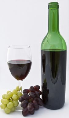 Glass Of Wine And Bottle With Grapes Royalty Free Stock Image
