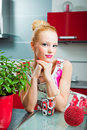 Free Blond Girl With Glass In Interior Of Kitchen Stock Image - 20090531