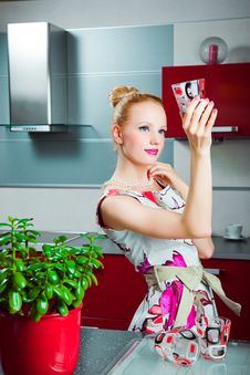 Free Housewife With Clean Glass In Interior Of Kitchen Royalty Free Stock Photography - 20090417