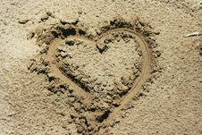Free A Heart Shape Drawn In The Sand Stock Photos - 20092623