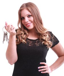 Free A Beautiful Woman Holding Keys Royalty Free Stock Photo - 20096045