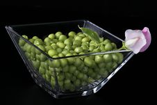 Fresh Peas In A Glass Vase Stock Images