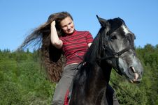 Free A Girl With Flowing Hair On A Black Horse Royalty Free Stock Images - 20097849
