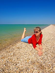 Free Beautiful Girl Relaxing On A Coastline Royalty Free Stock Photo - 20098915