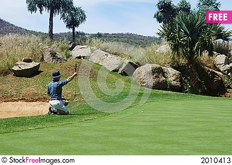 Golfer on the green. Stock Photo