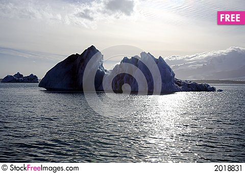 Silhouetted icebergs Stock Photo