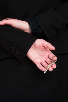 Free A Woman In A Black Suit Holding A Set Of Silver Keys Royalty Free Stock Photography - 2011147