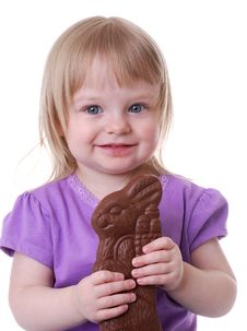 Toddler Holding A Chocolate Bunny Royalty Free Stock Images