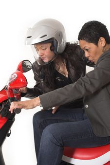 Couple Girls Talking On  Scooter Royalty Free Stock Photos