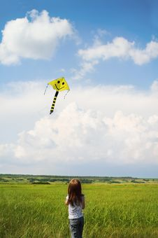 Free Little Girl With Flying A Kite Royalty Free Stock Images - 20101969