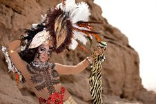 Free Tribal Female Wearing A Feather Head Gear Royalty Free Stock Photos - 20102478