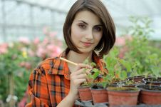 Girl In A Greenhouse Royalty Free Stock Images