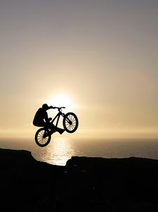 Free Sunset Biker Jumping Royalty Free Stock Images - 20102859