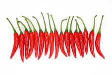 Free Red Chili Peppers On A White Stock Images - 20105364