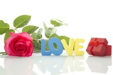 Red Rose, Gift Box And The Text LOVE Stock Images