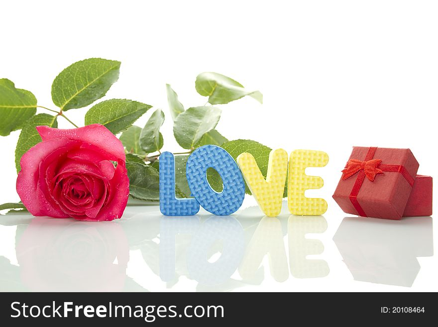 Red Rose, gift box and the text LOVE