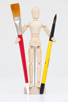 Artist S Wooden Mannequin With Brushes. Royalty Free Stock Image