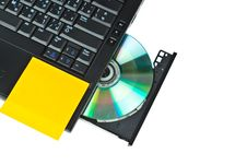 Free Close Up Of A Dvd In A Laptop Tray And Post-it Stock Image - 20112631