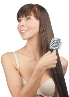 Free Woman Brushing Her Hair Stock Images - 20114034
