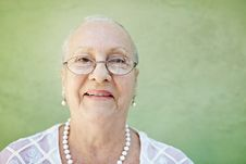 Free Aged Woman With White Hair Smiling At Camera Royalty Free Stock Images - 20114699