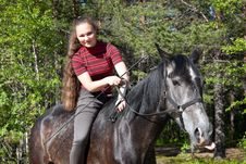 Free Beautiful Girl On Black Horse Royalty Free Stock Images - 20116169