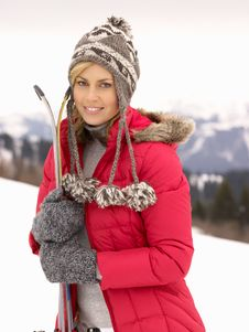 Young Woman Holding Skis In Alpine Landscape Royalty Free Stock Photography