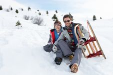 Free Young Father And Son In Snow With Sled Royalty Free Stock Images - 20117539