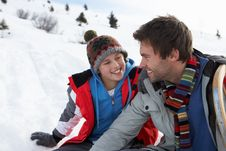 Young Father And Son In Snowy Landscape