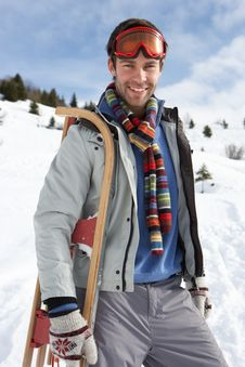 Free Young Man Carrying Sled In Alpine Landscape Royalty Free Stock Photography - 20117737