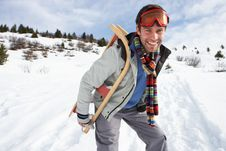 Free Young Man Carrying Sled In Alpine Landscape Royalty Free Stock Photography - 20117807