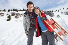Free Young Father And Son In Snow With Sled Royalty Free Stock Image - 20117856