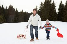 Young Father And Daughter Walking In Snow Stock Photography