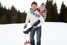 Free Young Father And Daughter In Snow With Sled Royalty Free Stock Images - 20119059
