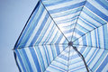 Free Blue Backlit Parasol Against Plain Sky Royalty Free Stock Photo - 20122455