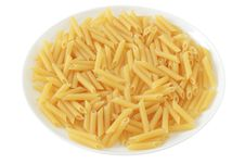 Free Dry Penne On A Plate Stock Images - 20120964