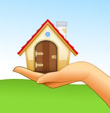 Woman's Hand Is Holding Small House Stock Images